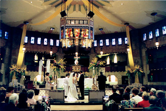 Ring exchange at Shrine of the Little Flower in Royal Oak wedding