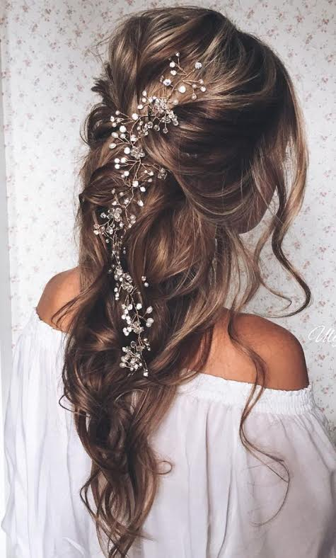 Long wedding day hairstyle headpiece loose braid