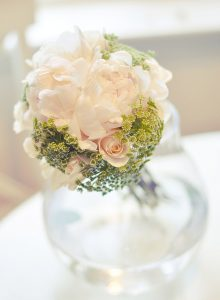 Delicate wedding center piece with blush flowers