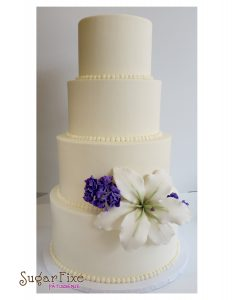 4 tier lily stock buttercream cake