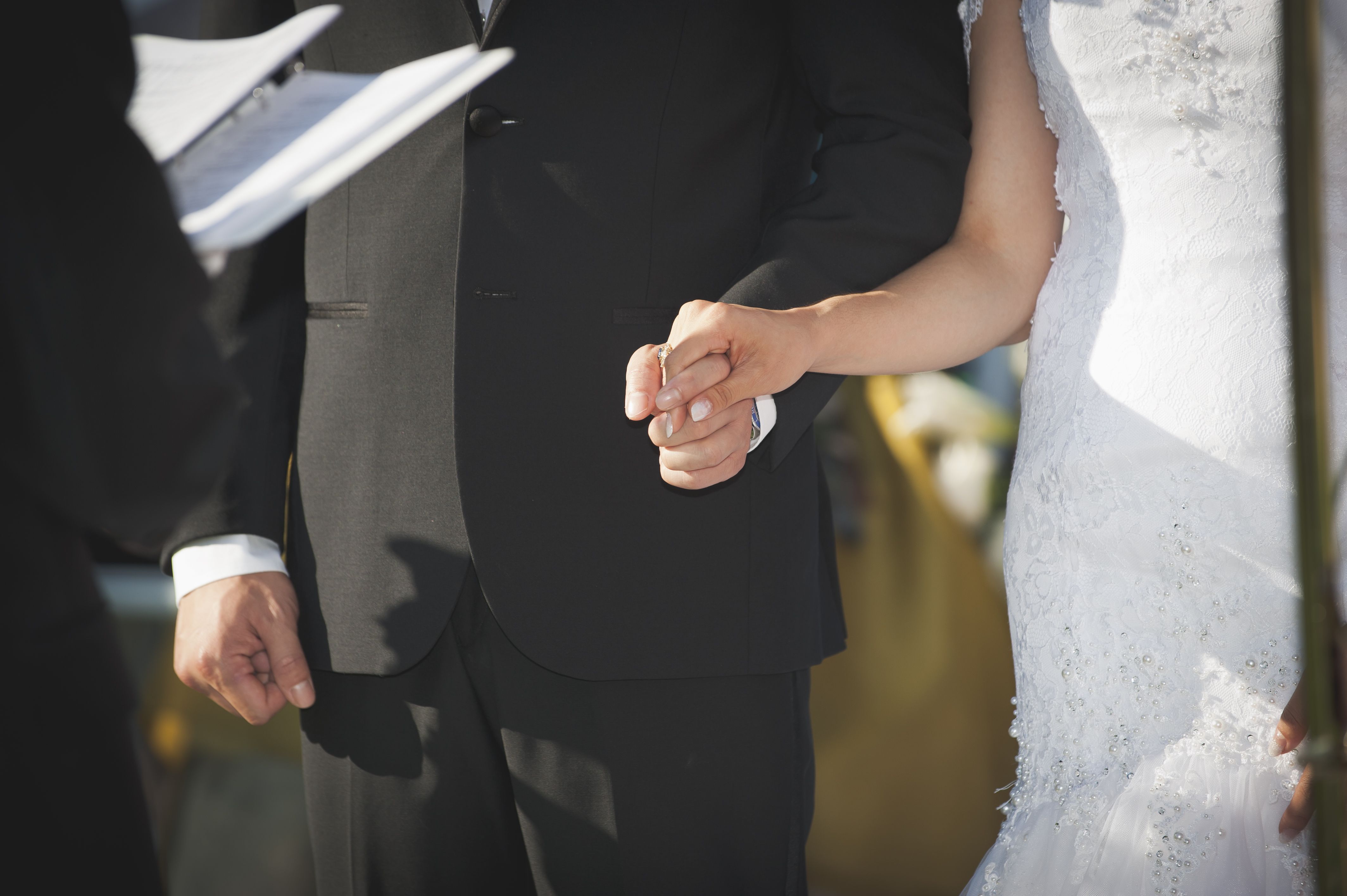 perfect wedding - bride and groom holding hands