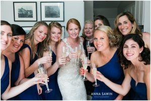Fun Wedding in Watch Hill, RI - Bride, Bridesmaids, and Champagne