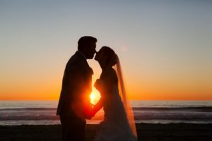 Bride and Groom Kiss at Sunset avoid these wedding regrets