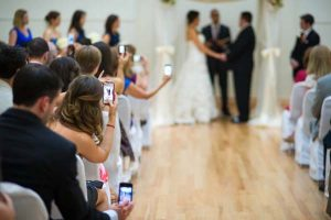 wedding guests block photographer